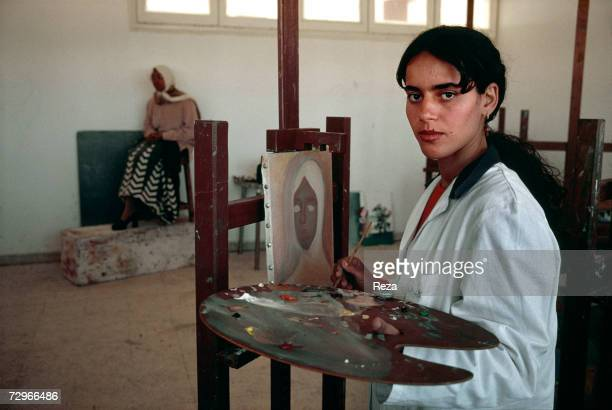 A young woman paints at the Faculty of Fine Arts at Al Fatah University on March 2000 in Tripoli Libya