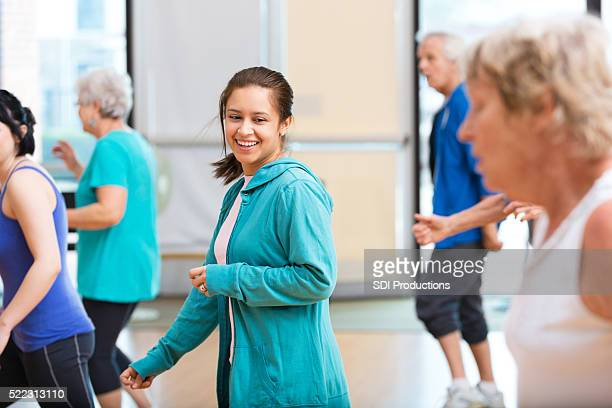 young woman participates in dance class - community centre stock pictures, royalty-free photos & images