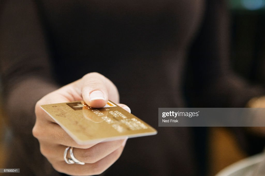 Young woman paying with a credit card : Stock Photo