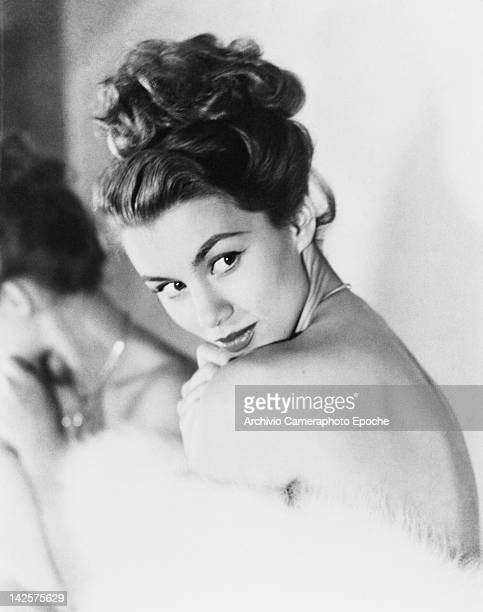 A young woman peers coyly over her shoulder circa 1948