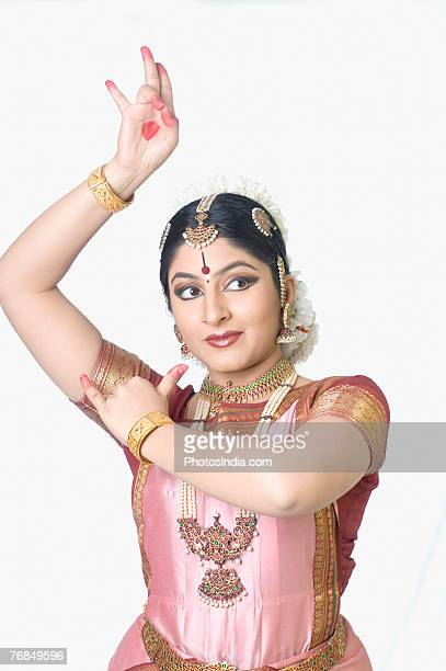 Young woman performing Bharatnatyam