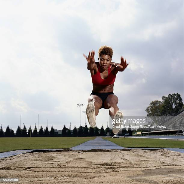 Young Woman Performing the Long Jump