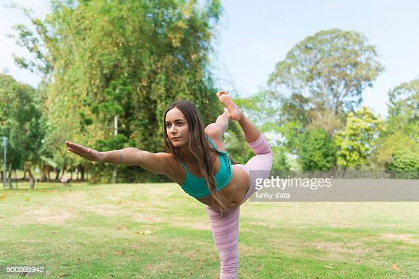 Young woman performing yoga at the park