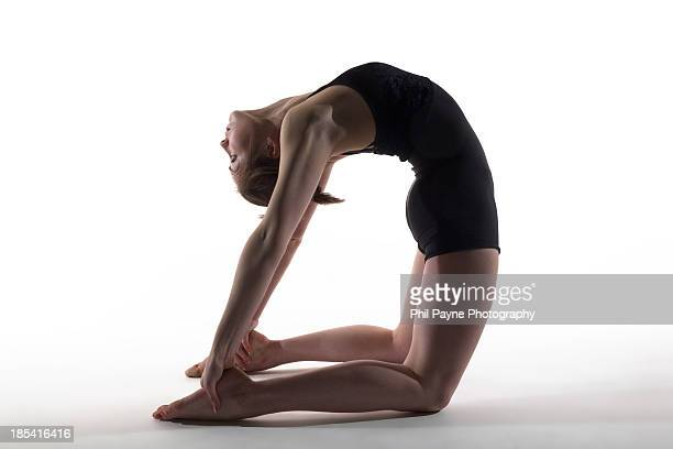 Young woman performing yoga back bend