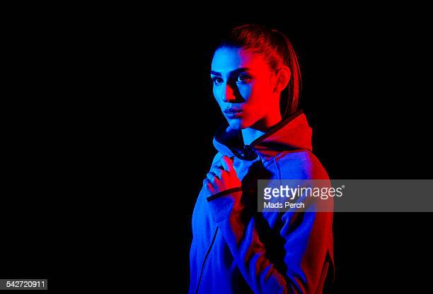 young woman photographed with creative lighting - illuminated stock pictures, royalty-free photos & images