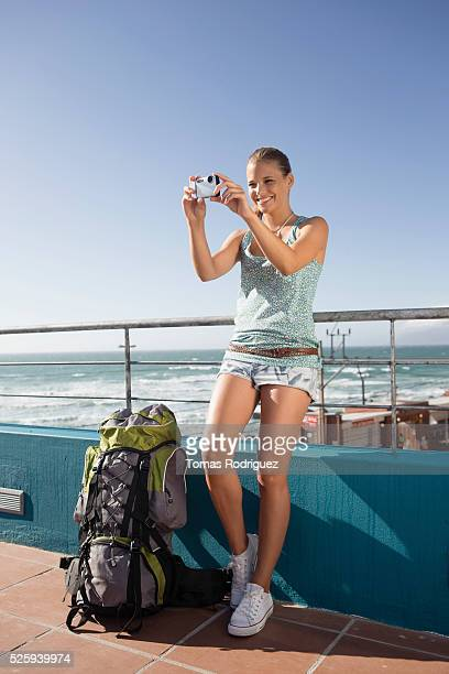 young woman photographing herself during sea trip on ferry - passenger craft stock pictures, royalty-free photos & images