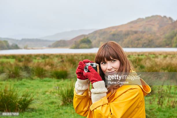 Young woman photographing landscape
