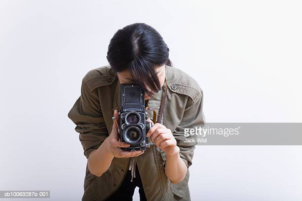 Young woman photographing