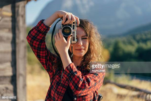 young woman photographing the autumn season - nice girls pic stock photos and pictures