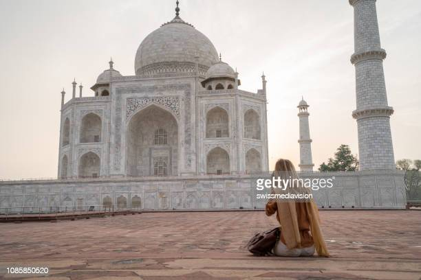 young woman photographing the famous taj mahal at sunrise using camera, agra, india. people travel asia concept - digital camera stock pictures, royalty-free photos & images
