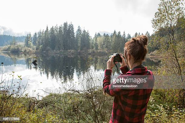Young woman photographing the landscape