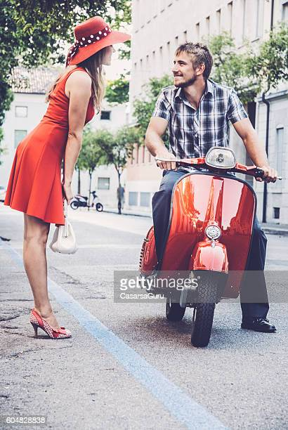 Young Woman Picking up a Ride on a Vintage Scooter