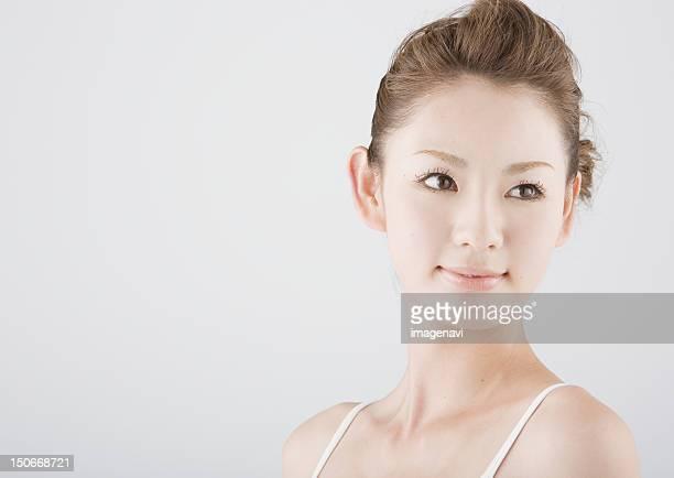 young woman - 後ろで束ねた髪 ストックフォトと画像