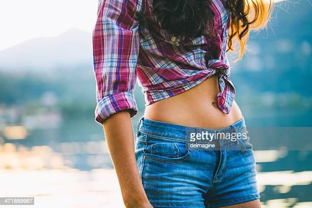 giovane donna - ombelico foto e immagini stock