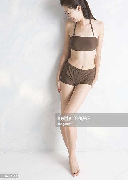 a young woman - hot pants stock pictures, royalty-free photos & images