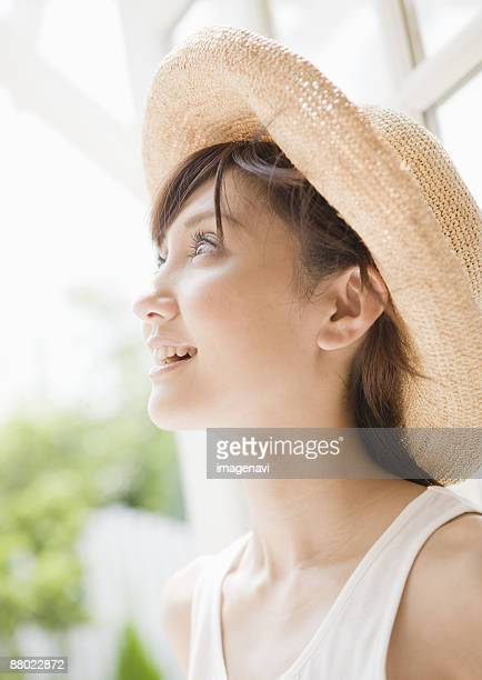 a young woman - 麦わら帽子 ストックフォトと画像