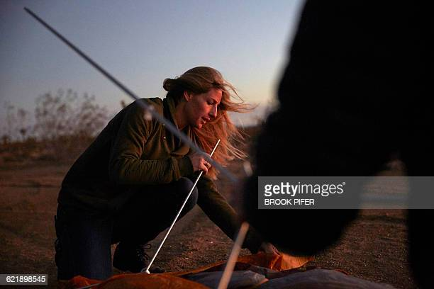 Young woman pitching tent