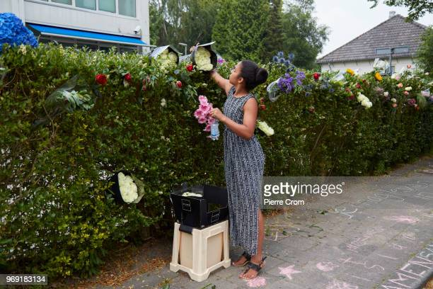 A young woman places flowers outside the Laleli Mosque on June 7 2018 in Rotterdam NetherlandsThe antiIslam group Pegida plans to roast pigs on a...