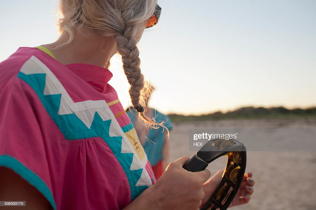 Young woman playing a tambourine : Stock Photo