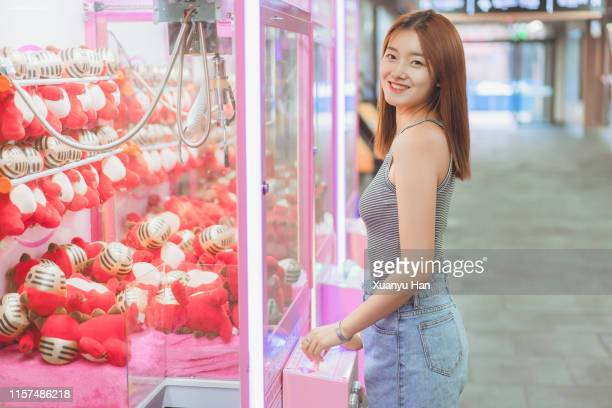 Young woman playing arcade game