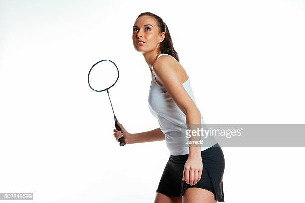 young woman playing badminton - badminton stock photos and pictures