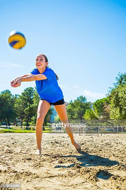 young woman playing beach volleyball - beach volleyball stock pictures, royalty-free photos & images