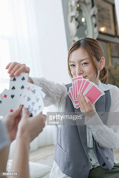 Young woman playing card