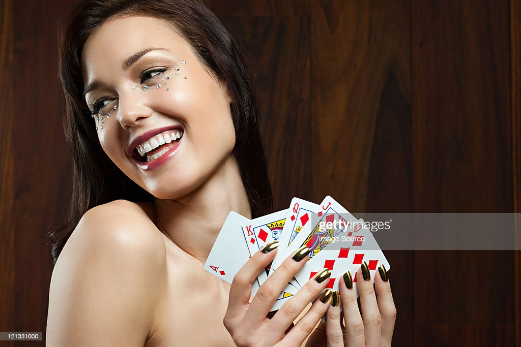 Young Woman Playing Cards Holding Royal Flush High-Res -2989