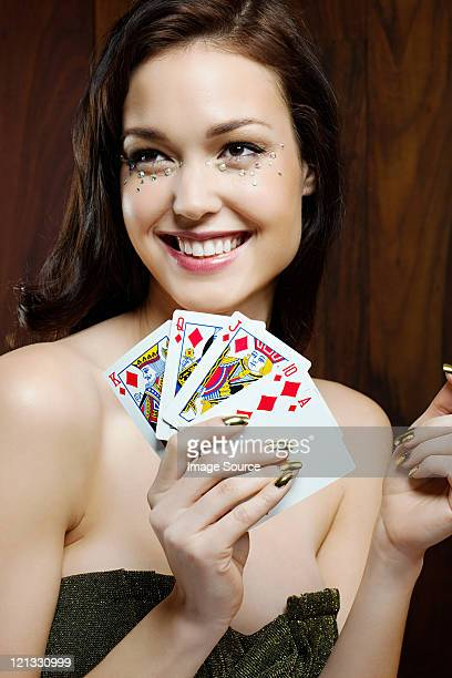 young woman playing cards - royal flush stock photos and pictures
