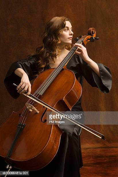 young woman playing cello - cellist stock pictures, royalty-free photos & images