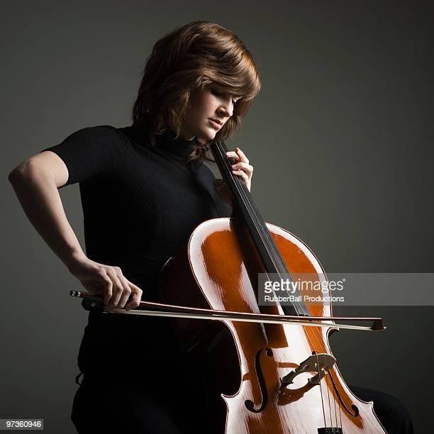 Young woman playing cello, studio shot