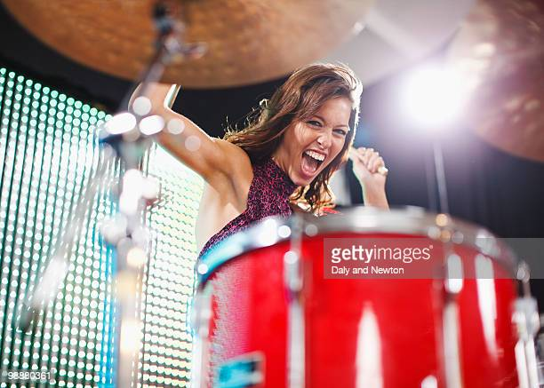 Young woman playing drums