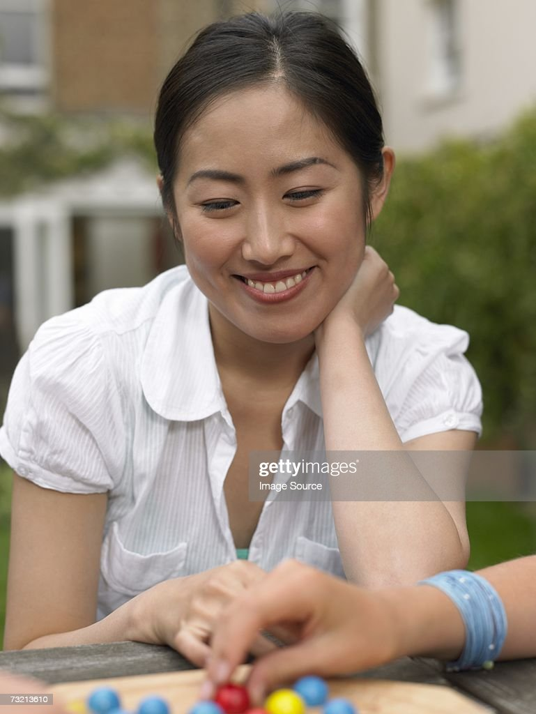 Young woman playing game : Stock Photo