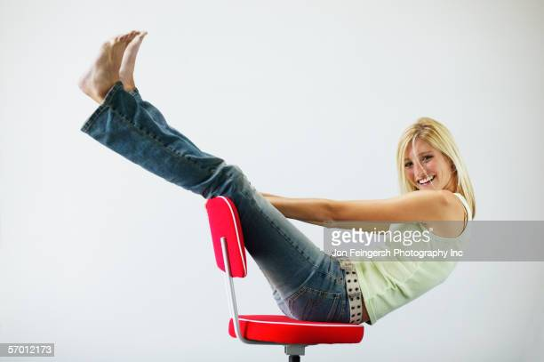 Young woman playing in a chair