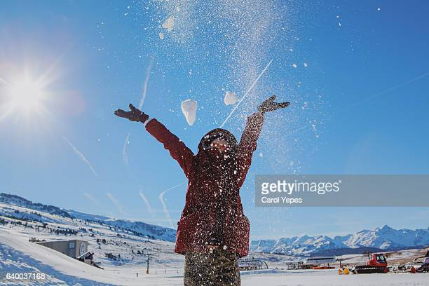 young woman playing snow
