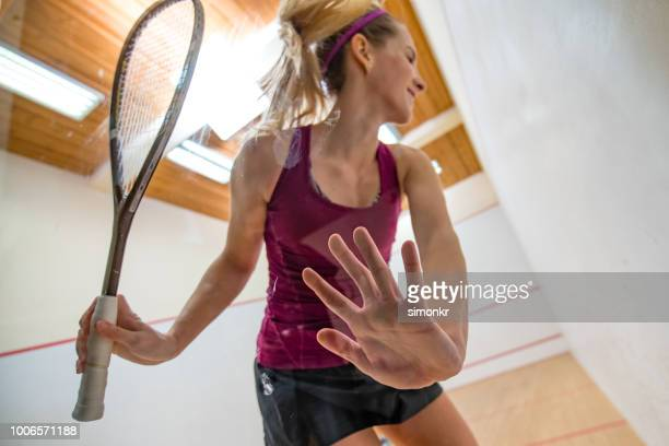 young woman playing squash game - racquet stock pictures, royalty-free photos & images