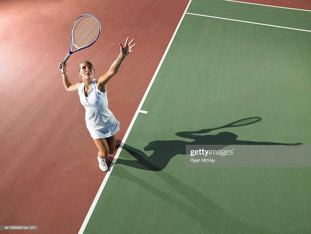 Young woman playing tennis, elevated view : Stock Photo