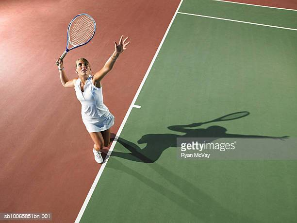 young woman playing tennis, elevated view - tennis stock-fotos und bilder