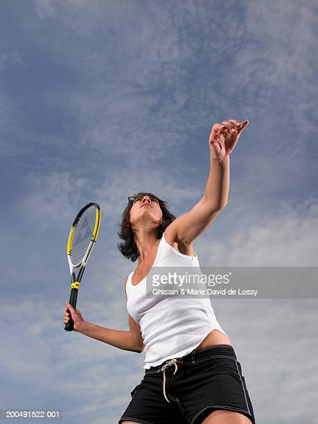 young woman playing tennis, low angle view - saint ferme stock photos and pictures