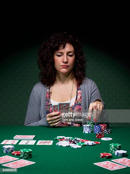 Young woman playing Texas Hold'em poker.
