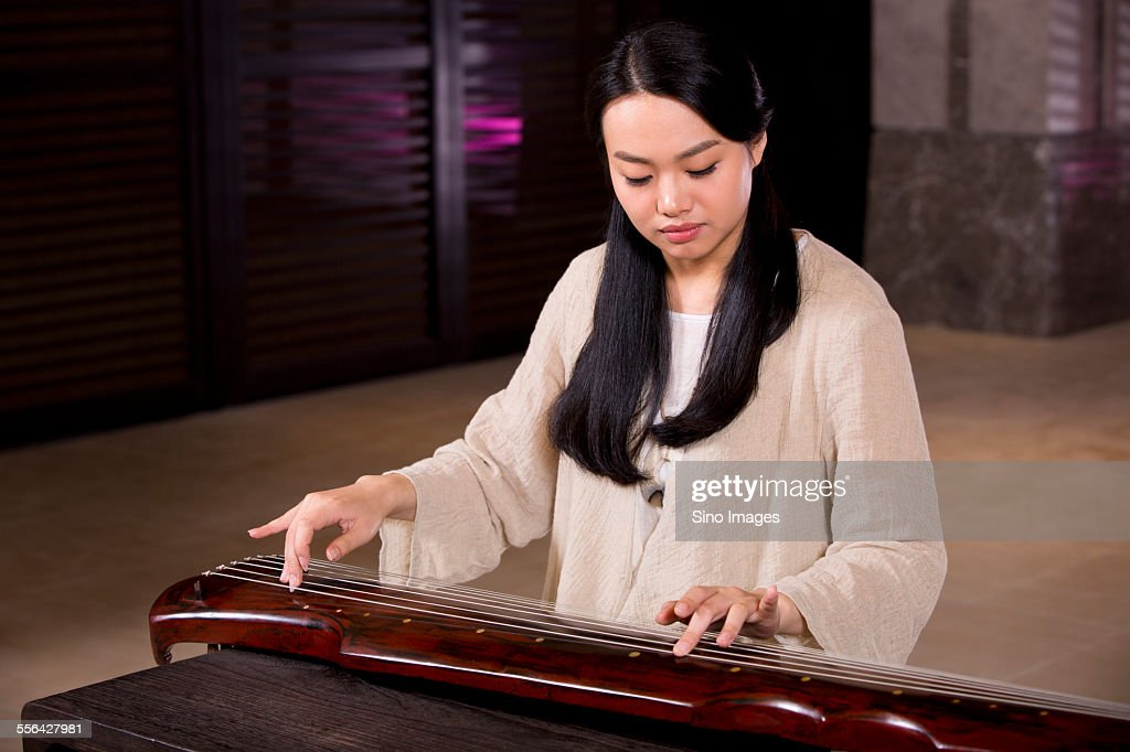 Young Woman Playing the Guqin : Stock Photo