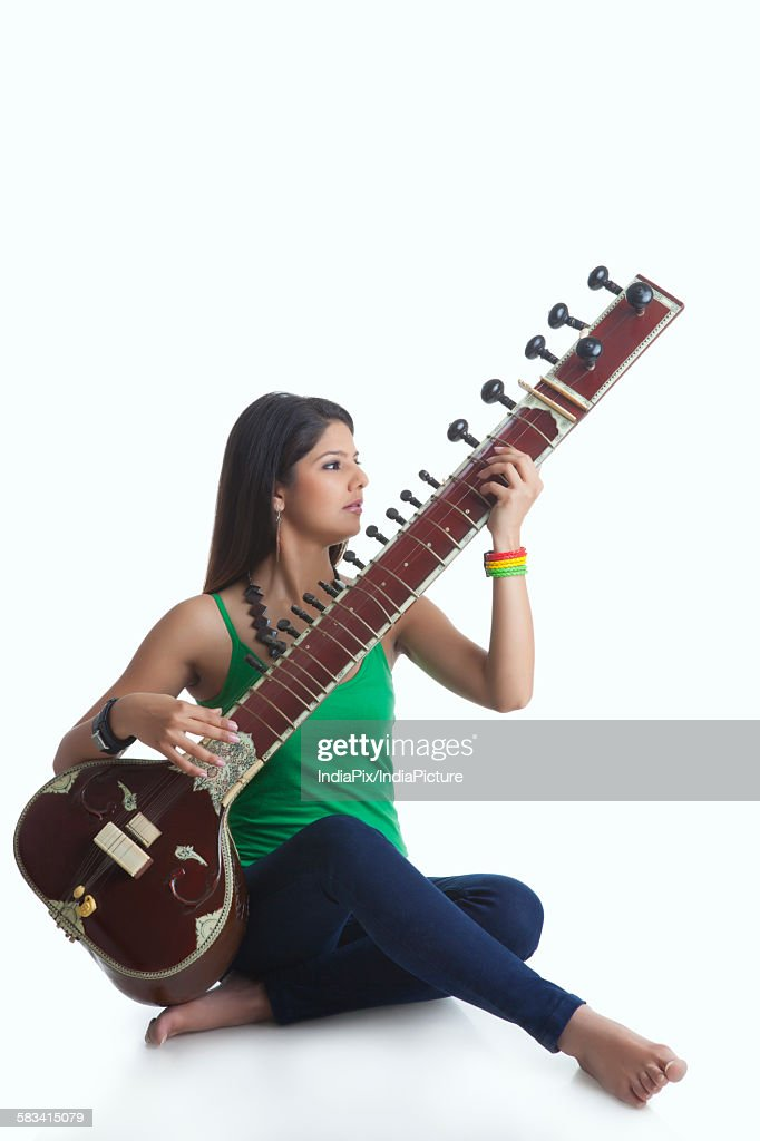 Young woman playing the sitar : Stock Photo