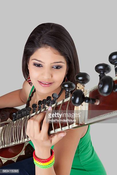 Young woman playing the sitar
