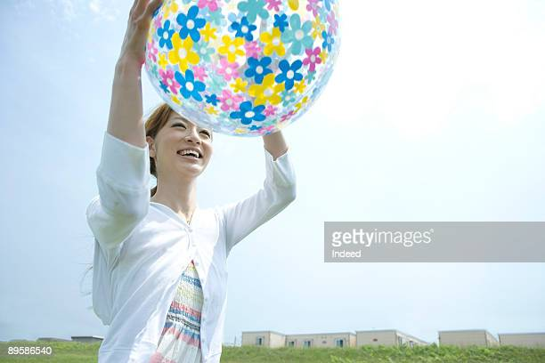 Young woman playing with ball