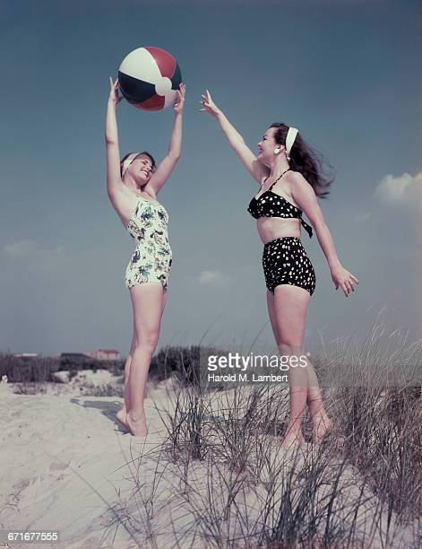 Young Woman Playing With Beach Ball
