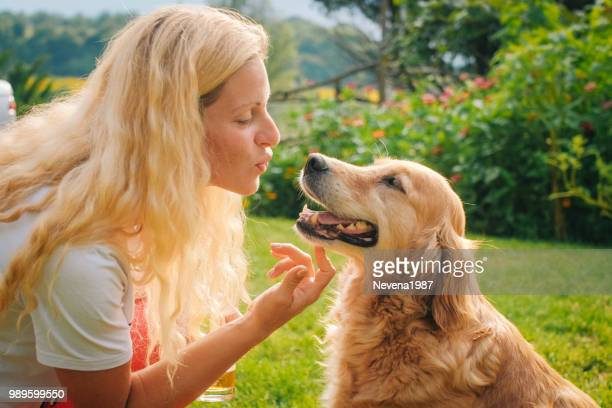 young woman playing with her dog outdoor. - descrever imagens e fotografias de stock