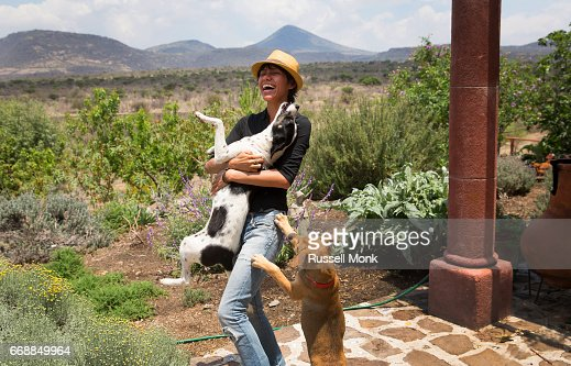 Young woman playing with her dogs