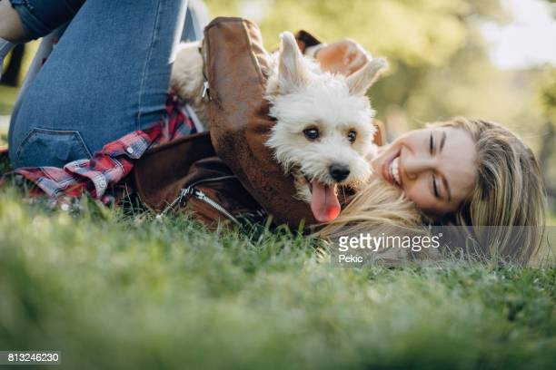 Young woman playing with her lovely dog