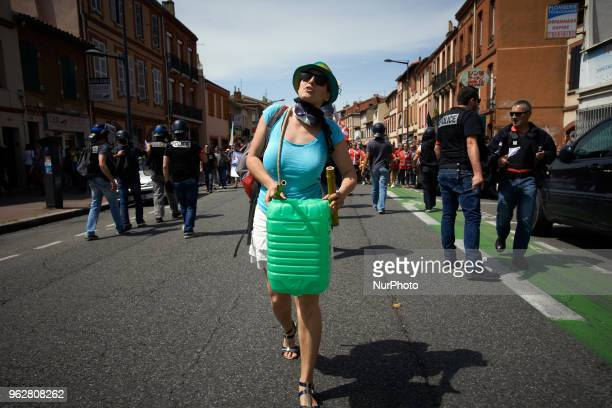A young woman plays drums in front of riot police during the demo A quotmaree populairequot demonstration was called by more than 60 political...