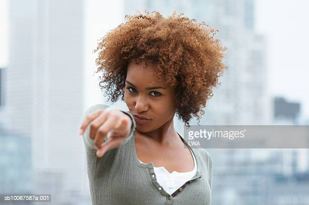 young woman pointing, portrait - one young woman only stock pictures, royalty-free photos & images